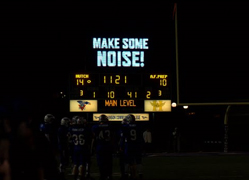 Scoreboard displaying 'Make Some Noise' message